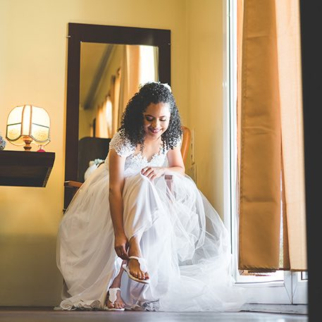 Woman putting on wedding shoes at Colgate Inn